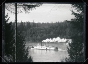 Photograph, view of a boat on the Willamette River in front of the Finley house, taken from study window (Dec. 1907)