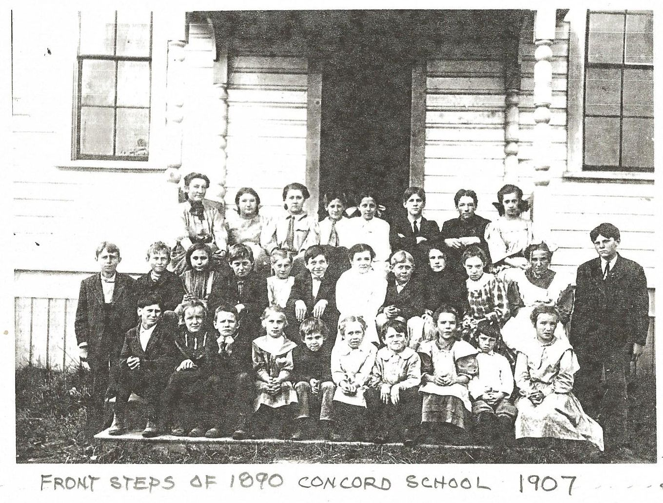 Photo of the 1907 Concord School student body, on the steps of the 1890 (first) Concord school building