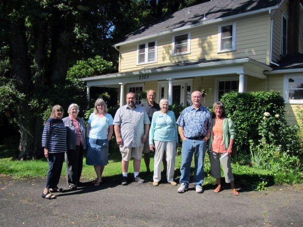 Photo of OLHD members and host Pascale Steig standing in fron of the Isabelle Rupert House, Saturday September 14th, 2013